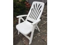 White plastic garden recliner chair with foot rest