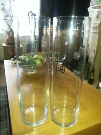 Matching pair of clear tall tubular glass vases £10