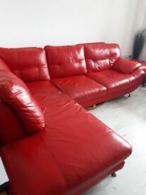 RED LEATHER CORNER SETTEE & POUFFE