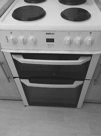 White electric cooker 60in width black rings. Excellent condition only 2years old. Cost 370