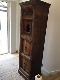 Pair of handmade tall sheesham cabinets with decorative carved panel