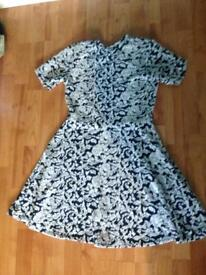 Beautiful and comfy dress. Navy and cream. Ex con
