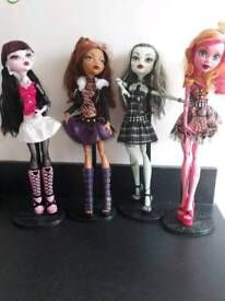 4 monster high dolls with stand and 5 DVDs bargain price
