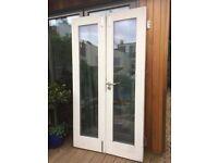 Double glazed hardwood doors.
