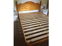 King size Wooden bed frame. Unmarked condition. Dismantled. Buyer to collect