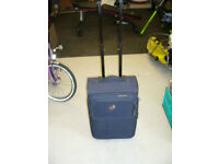 Two Travel/Weekend Suitcases. On rollers with extending pulling handles