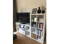 White ikea tv cabinets and book shelves