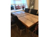 Dining room table and 5 matching chairs in dark brown