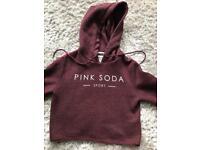Girl's Pink Soda hoodie.