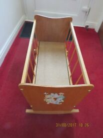 Child's rocking toy cot