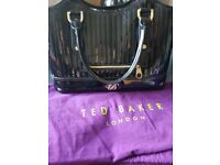 Genuine ted baker patent bag with removable clutch.
