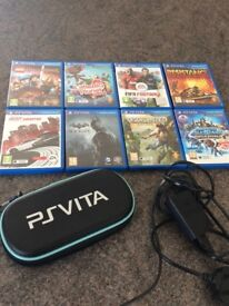 Playsation Vita with Case, Charger and 8 games