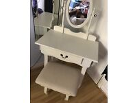 Dressing table with mirror and stool.