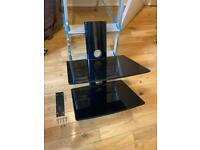 Wall mounted TV stand with glass shelves