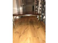 solid wood coffee table with ornate metal legs