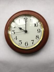 Round wooden backwards clock