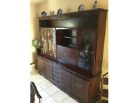 Mahogany Display Glass Cabinet with lighting. Bottom section contains cupboard space and drawers.