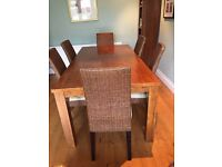 Zen Interiors Rubber Wood Dining Table with 6 x Rattan and Sand & Chenille chairs.
