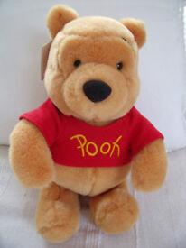 Winnie The Pooh soft toy (in sitting pose) from Disneyland, Paris, with original tag. £6 ovno.