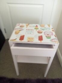 Vintage/retro table painted in shabby chic baby pink with a distressed look finish.