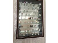 Thimble collection in display cabinet.