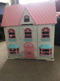 Dolls house with furniture. Hardly used.