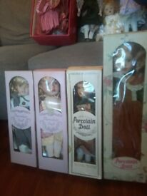 porcelain dolls in boxes