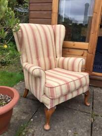 Fabric covered wingback armchair