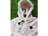 Girls pink fluffy onesie. Age 7-8 years. Brand New