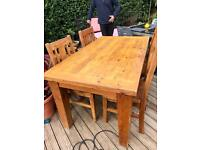 Solid wood table with 4 x chairs.