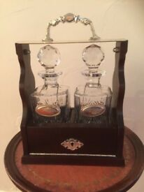A double drinks decanter tantalus
