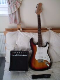 ELECTRIC GUITAR AND AMP PACKAGE.