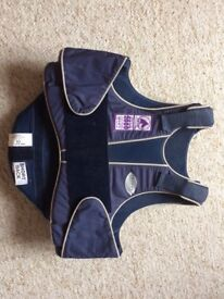Childs Champion Blue Body Protector Size Medium. Chest size 64 to 72cm.