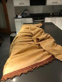 Gold damask drapes with fringed edging