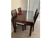 Solid, dark wood dining table and 4 chairs FOR SALE