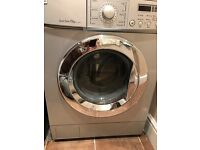 LG Silver/Grey 7.5KG washing machine, good working order. Must collect. £50.