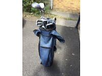 Golf clubs in zip top cover bag