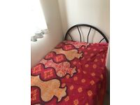 Single metal bed with mattress, good condition