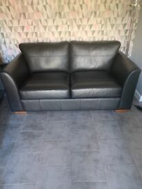 Black leather sofa.