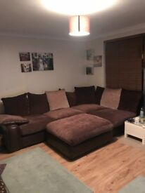 Large corner sofa and pouffe for sale super comfy great condition.