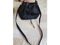 Black draw string bag
