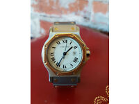A fine quality boxed Cartier Santos 18K and steel automatic wrist watch with date aperture,