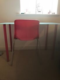 Glass top desk, pink metal legs and pink chair