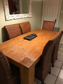 Large dining table with 6 wicker chairs