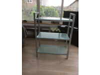 Metal and glass shelf unit. Top and two shelves.