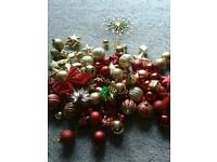 100 assorted red and gold baubles