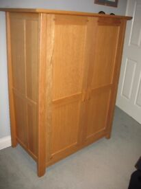 Light oak computer cupboard with sliding shelves and generous storage. £100 for quick sale.
