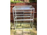 4ft freestanding toughned glass growhouse with three shelves. Ideal for small garden.