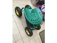 Rolling garden cart work seat with heavy duty tool tray