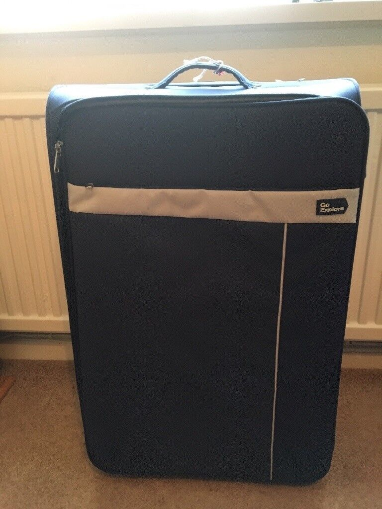 Large blue suitcase two wheels